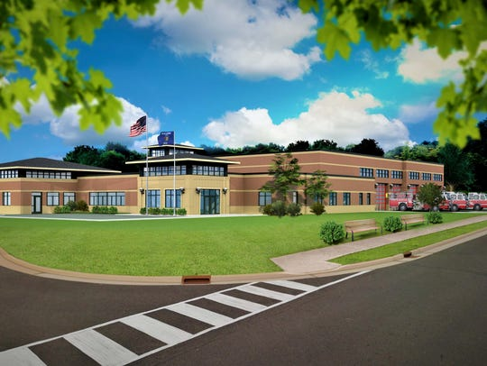 An architectural drawing shows the design of the new Greenville fire station.