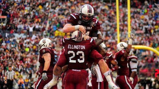 South Carolina quarterback Connor Shaw celebrates a touchdown with wide receiver Bruce Ellington.