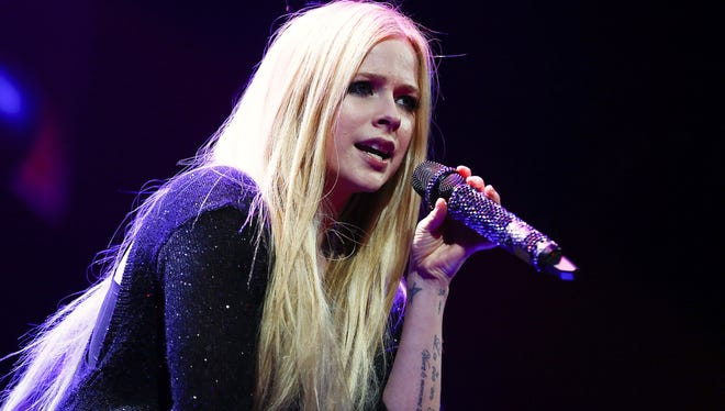 Avril Lavigne performs at the 103.5 KISS FM's Jingle Ball 2013 at United Center on December 9, 2013 in Chicago.