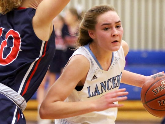 Brookfield Central's Anna Mortag drives under Brookfield East's Emma Kiekhofer at Central on Dec. 8.