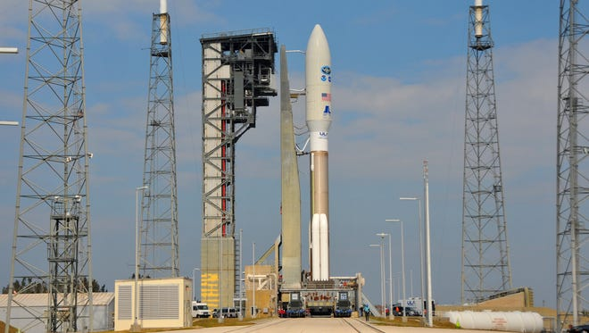 A NOAA GOES-R weather satellite aboard a United Launch Alliance Atlas V rocket, is rolled out to Launch Complex 41 at Cape Canaveral Air Force Station in Florida on Friday, Nov. 18, 2016. The rocket is scheduled to launch at 5:42 p.m., on Saturday.
