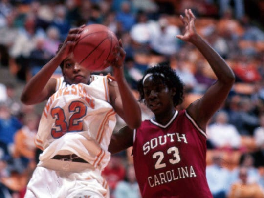 Daedra Charles grabs the rebound against South Carolina.