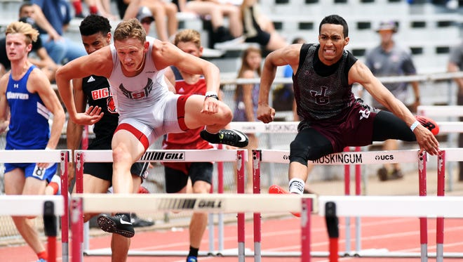Sheridan's Ethan Tabor, left, and John Glenn's Justin Clifford run the 110 high hurdles during a Division II regional track meet on Saturday at McConagha Stadium. Clifford edged Tabor, his longtime rival, by just :00.03 to advance to the state competition.