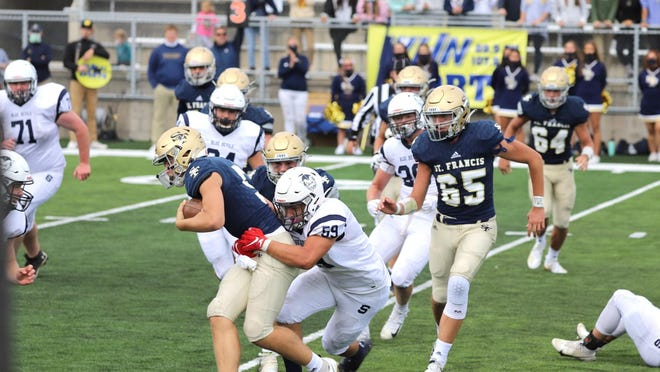 Sault High middle linebacker Daylan Lujan hauls down a Traverse City St. Francis runner duing a game this season. Lujan is the Co-Defensive Player of the Year in the Northern Michigan Football League Legends Division.