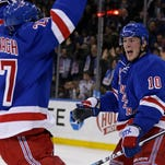 Rangers center J.T. Miller, right, celebrates with Ryan McDonagh after scoring the winning goal in overtime against Vancouver on Tuesday night.