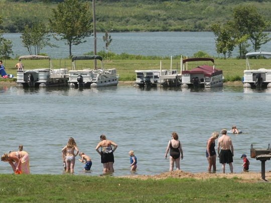 Enjoy swimming, volleyball, kayaking or paddling during a day at Big Creek Lake in Polk City.