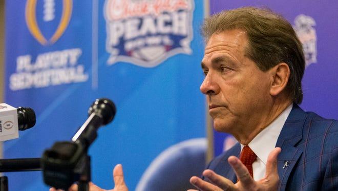 Alabama football coach Nick Saban talks with the media during a Peach Bowl NCAA college football news conference.