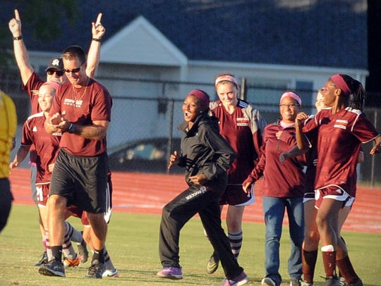 Snow Hill's girls soccer team celebrates its win against