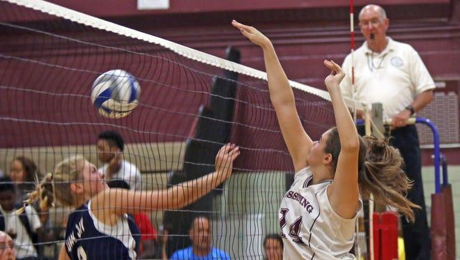 John Jay East Fishkill plays Ossining in girls volleyball at Ossining High School on Tuesday, Sept. 6, 3016.