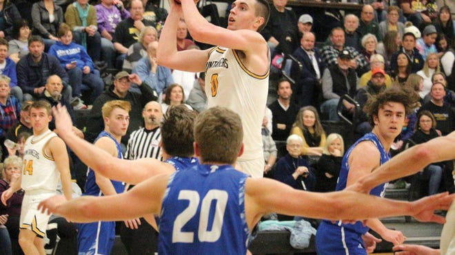 Iron Mountain's Foster Wonders pulls up for a jump shot versus Gwinn during a game last season at Iron Mountain High School.
