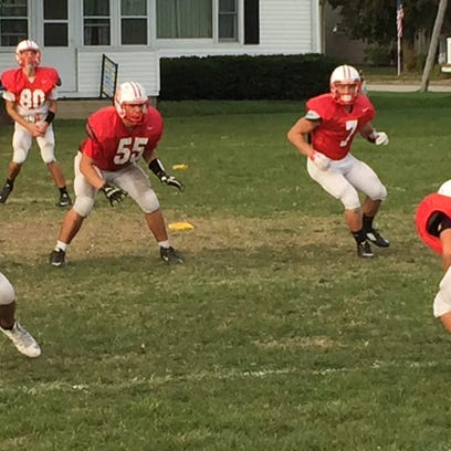 Port Clinton's Eric Wheeler, 55, and Emerson Lowe practice