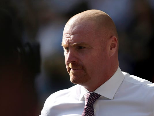 FILE - In this Sunday, Aug. 27, 2017 file photo, Burnley's manager Sean Dyche looks on during the English Premier League soccer match between Tottenham Hotspur and Burnley at Wembley stadium in London. Burnley is mixing it with the heavyweights of the Premier League despite being tipped for a season of struggle. The modest northwest team is tied on points with sixth-place Liverpool after 10 games and its manager Sean Dyche is being linked with the vacancy at Everton. (AP Photo/Tim Ireland, File)