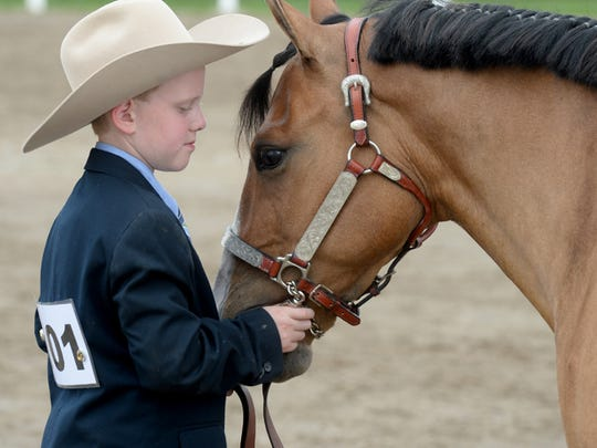 Alex Logue presents during a horse show Saturday, June
