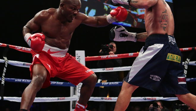 Former WBO Welterweight champion boxer and Cathedral City, Calif. native Timothy Bradley, Jr. (red trunks) fights Diego Chaves (navy trunks) on Saturday, December 13, 2014 at The Cosmopolitan of Las Vegas. The fight ended in a draw.