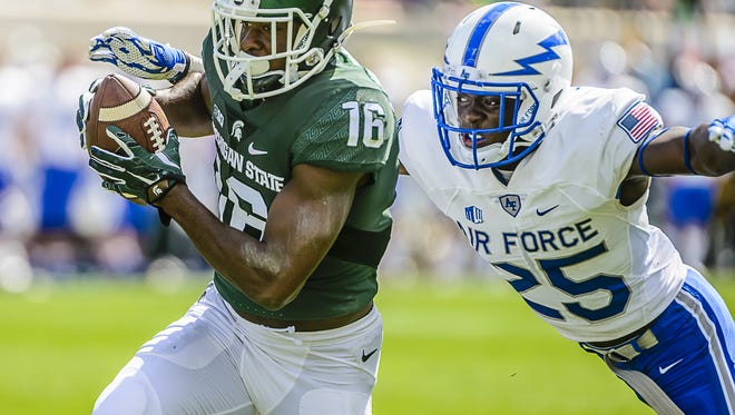 Aaron Burbridge beats Air Force's Roland Ladipo for a touchdown catch late in the second quarter Saturday at Spartan Stadium.