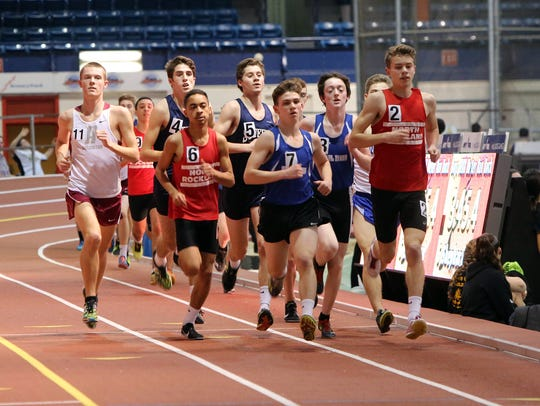 Runner compete in the boys 3200m race at the Rockland