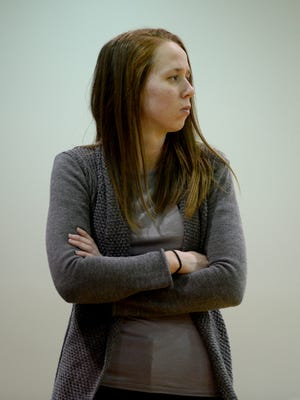 Former Earlham College head women's basketball coach Janel Iden watches game action against Mt. St. Joseph during a 2015 game.