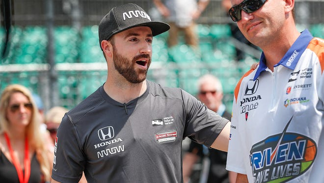 Schmidt Peterson Motorsports IndyCar driver James Hinchcliffe (5) talks with friends along Pit Road during Pole Day at the Indianapolis Motor Speedway on Sunday, May 20, 2018. for the Indianapolis 500.
