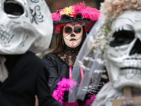 Dressed in traditional Day of the Dead garb, Faby Marquez