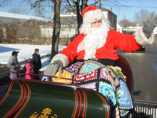 Santa Claus waves to the crowd during the West Lafayette Christmas parade in this Tribune file photo.