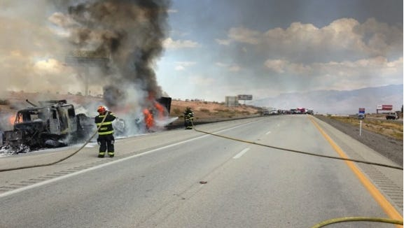 Mesquite Fire and Rescue Firefighters try to control the semi fire on I-15.