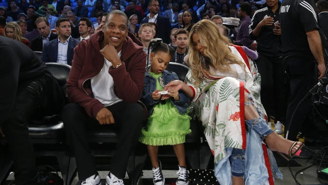 """Jay Z — with his his wife, Beyonce, and their daughter Blue Ivy at a basketball game in February — plans to release his new album """"4:44"""" later this month."""