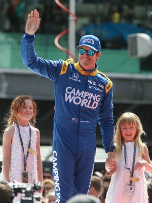 Pole winner Scott Dixon is introduced before the start of the 101st running of the Indianapolis 500 at Indianapolis Motor Speedway, Sunday, May 28, 2017.
