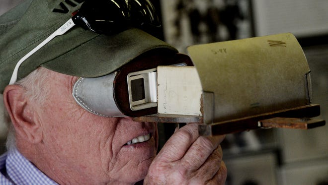 Larry Downing, looking through a stereoscope, has been widely credited with bringing new life to the Port Hueneme Historical Society Museum.