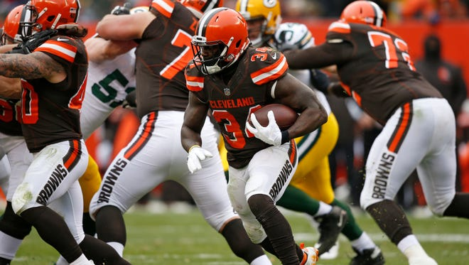 Cleveland Browns running back Isaiah Crowell (34) runs the ball against the Green Bay Packers in the second half of an NFL football game, Sunday, Dec. 10, 2017, in Cleveland.