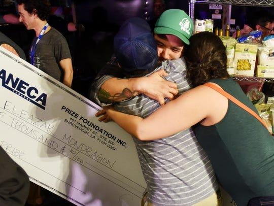 Eleazar Mondragon gets hugs from family after winning