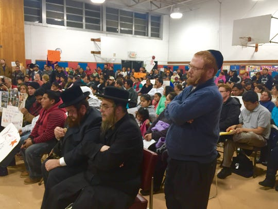 Ultra-Orthodox community members, public school parents