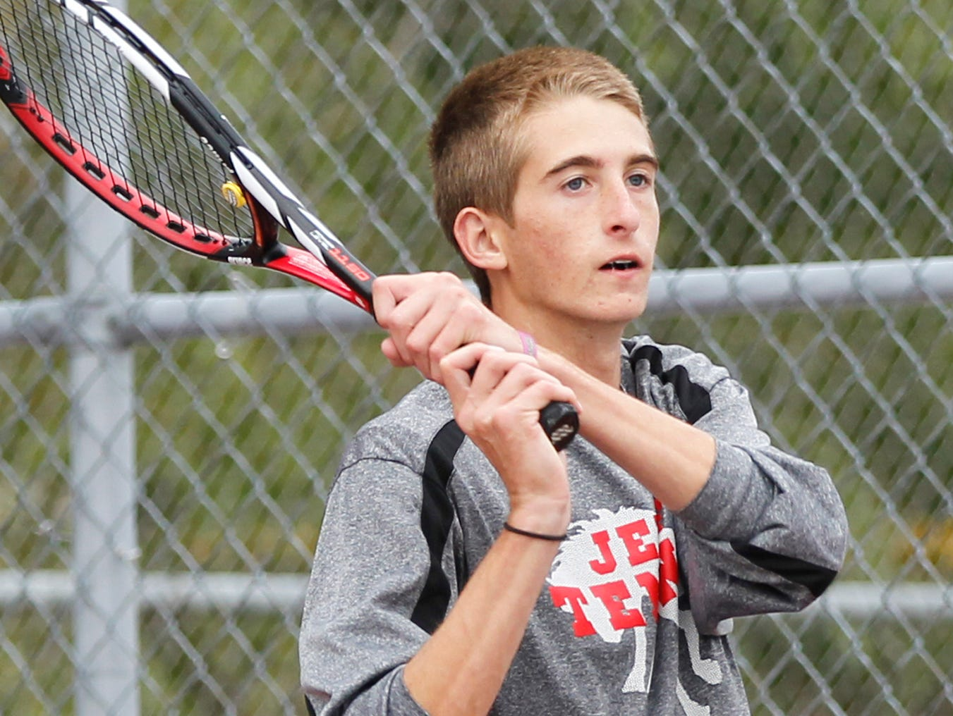 Lafayette Jeff's Brayden Williams watches his return as he and teammate Aden Beaver battle West Lafaytte's Brian Mi and Jethro Zhou at No. 1 doubles during the boys tennis sectional championship Friday, October 2, 2015, at Cumberland Courts in West Lafayette.