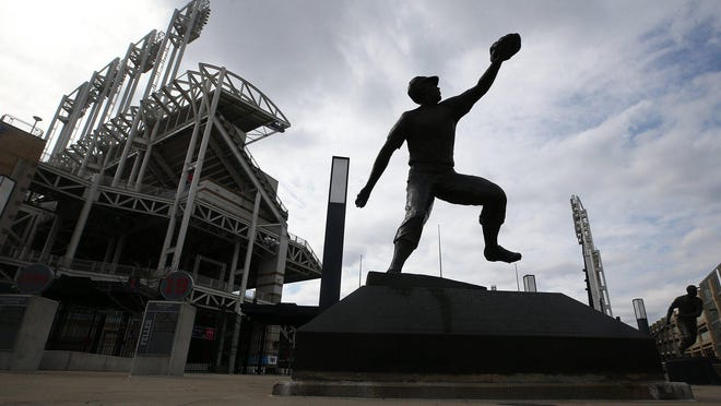 A Bob Feller statue stands outside Progressive Field in downtown Cleveland. Police arrested five people Friday who they said were attempting to break into facility.