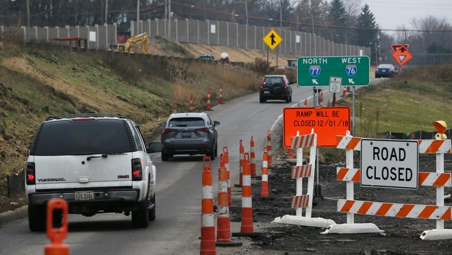 Construction cones at the entrance ramp to I-76/77 in Akron.