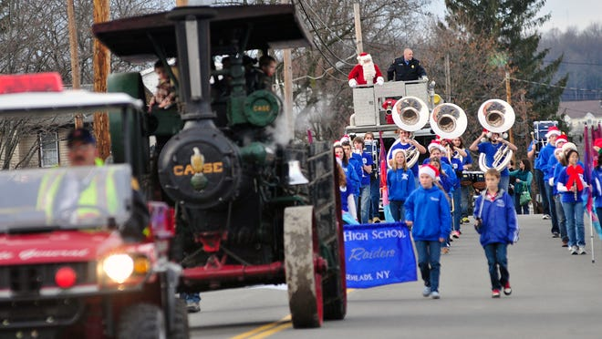 A steam engine fire truck and the Horseheads High School marching band lead Santa into Hanover Square for the 2012 Holly Days event in the village of Horseheads.
