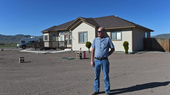 Larry Robbins stands at his property in Warm Springs Valley on March 27, 2015.