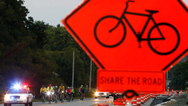 Cyclists begin a memorial ride Thursday for Phillip Bishop from Lantana Square  to his viewing at Chandler Funeral Home on Lancaster Pike in Hockessin.