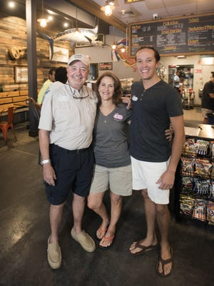 Dog House Deli owner Jim Holler, from left, along with his wife Sharon and his son Nathan will be celebrating the restaurant's 40th year of business on Palafox Place on Thursday, Sept. 7, 2017.