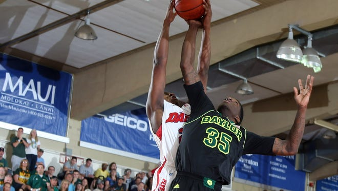 Dayton Flyers forward Kendall Pollard (22) battles for a rebound with Baylor Bears forward Taurean Prince (35) during the second round at the EA Sports Maui Invitational at the Lahaina Civic Center.