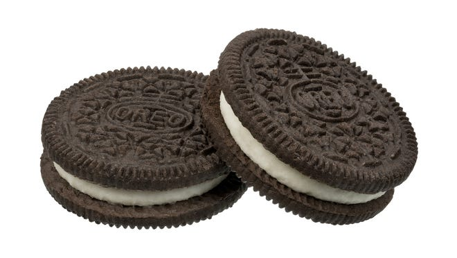 Ten football players at a Northern Illinois high school were suspended from the team for three games last month after they ran across a field naked with Oreo cookies wedged between their buttocks.