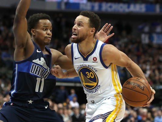 Golden State Warriors guard Stephen Curry (30) drives against Dallas Mavericks guard Yogi Ferrell (11) during the first half of an NBA basketball game in Dallas, Wednesday, Jan. 3, 2018. (AP Photo/LM Otero)