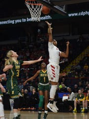 Marist College's Alana Gilmer hits a layup against