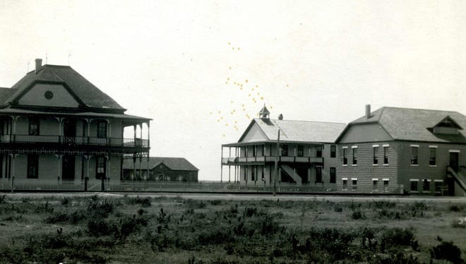 Bay View College in Portland, about 1913, included the main building and girls' dormitory (the old Portland Hotel) left, a one-story gymnasium, a two-story boys' dormitory, and a two-story chapel. The boys' dormitory and chapel were built of bricks made by the school's founder, Professor T.M. Clark.