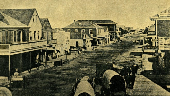 Main Street in Indianola in 1873 when it was known as the Queen City of the West and was beginning to rival Galveston as Texas' greatest port. The city was all but destroyed by two hurricanes in 1875 and 1886.