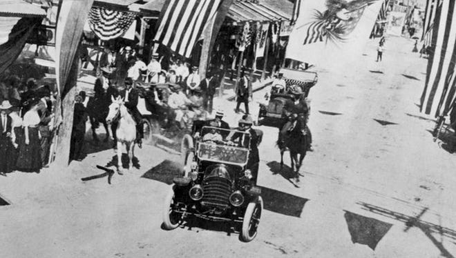 A seven-passenger Rambler with President Taft in the back seat makes the turn from Schatzel onto Chaparral, decorated with bunting for the president's visit. It was on Oct. 22, 1909.