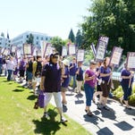 SEIU Local 503 marches to the Department of Administrative Services building in downtown Salem on Friday, June 28, 2013.