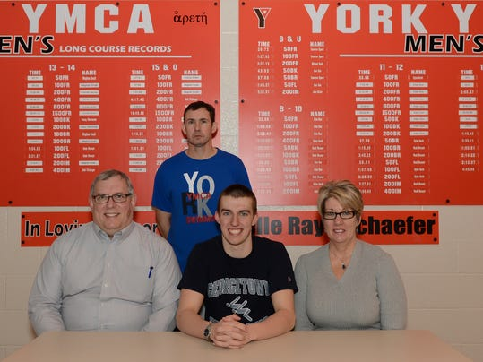 York YMCA standout Dan Ross signs his letter of intent to swim at Georgetown.