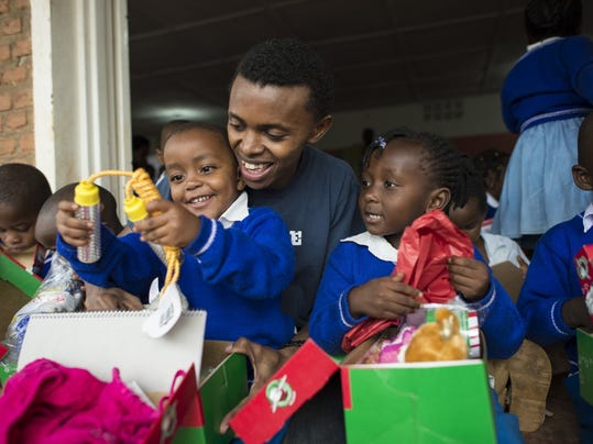 Alex with shoe box kids.jpg