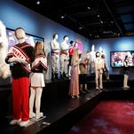 """FILE - In this May 28, 2015 file photo released by Premier Exhibitions, costumes worn by the cast of """"Saturday Night Live,"""" are displayed at the """"Saturday Night Live: The Exhibition,"""" in New York.  Located on Manhattan's Fifth Avenue a dozen blocks south of """"SNL's"""" home at 30 Rockefeller Plaza, the exhibition is a satisfyingly immersive experience, steering visitors step by step, room to room, through the improbable yet tried-and-true process of putting together each show in just six days. (Brian Ach/Premier Exhibitions via AP)"""