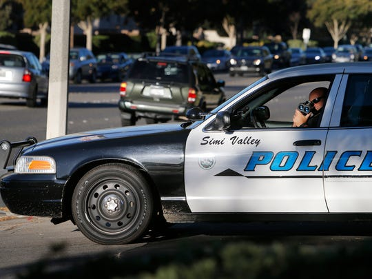 Police Cmdr. Robert Arabian uses radar to monitor traffic Tuesday in front of Simi Valley High School.